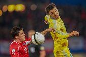 VIENNA,  AUSTRIA - OCTOBER 16: Zlatko Junuzovic (#10 Austria) and Kairat Nurdauletov (#6 Kazakhstan)