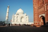 Tourists visiting famous landmark of India - Taj Mahal monument listed as UNESCO World Heritage