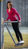 Woman exercising in autumn park