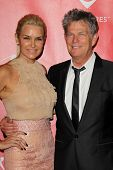 LOS ANGELES - FEB 8:  Yolanda Hadid, David Foster arrives at the 2013 MusiCares Person Of The Year G