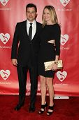 LOS ANGELES - FEB 8:  Jimmy Kimmel; Molly McNearney arrives at the 2013 MusiCares Person Of The Year