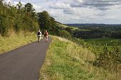 stock photo of dork  - People walking path on North Downs near Dorking in Surrey - JPG