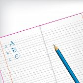 First Grade Copybook With Pencil