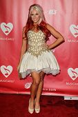 LOS ANGELES - FEB 8:  Bonnie McKee arrives at the 2013 MusiCares Person Of The Year Gala Honoring Bruce Springsteen  at the Los Angeles Convention Center on February 8, 2013 in Los Angeles, CA