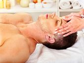 stock photo of beauty parlour  - Man getting facial  massage in beauty spa - JPG
