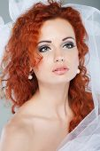 Portrait of beautiful redheaded bride. Wedding dress. Wedding decoration