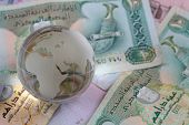 picture of dirhams  - crystal globe on uae currency dirham notes - JPG