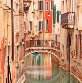Venice, Bridge On Water Canal And Traditional Architecture