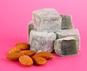 rahat lokum and nuts on pink background
