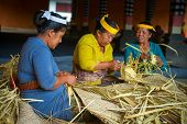 Balinese Women Make Baskets For Offerings