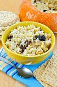 Rice porridge with pumpkin on the board