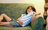 Little Girl Relaxing On Couch