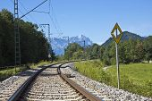 picture of bavarian alps  - Lonesome railway in the bavarian alps with mountains in the background - JPG