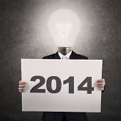 Businessman With Light bulb-head Showing Year 2014