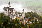 Neuschwanstein Castle shrouded in mist in the Bavarian Alps of Germany.
