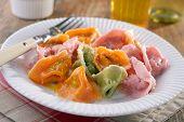 Multi-colored ravioli with spinach and ricotta