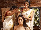 stock photo of panchakarma  - Young woman having head ayurveda spa treatment - JPG