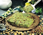 stock photo of bangla  - Famous Indian and Pakistani desert  sweet made with pistachio and butter oil - JPG