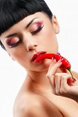 stock photo of red hot chilli peppers  - Spicy lady holding red hot chilly peppers - JPG