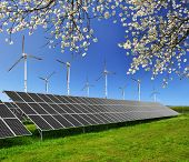 image of turbines  - Solar energy panels and wind turbines against blue sky - JPG