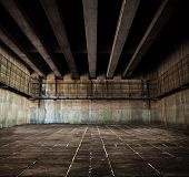 Concrete space with tiled floor and ceiling of concrete beams.