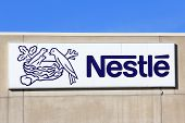 Sign Nestle With Blue Sky