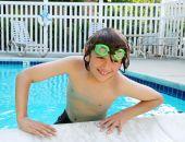 Teen Boy Enjoying Swimming Pool