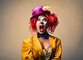 portrait of a beautiful clown screaming