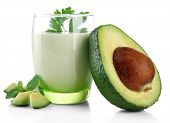stock photo of avocado  - Fresh avocado smoothie isolated on white - JPG