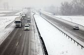 Highway traffic in heavy snowfall