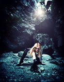 Sexy Woman with dragon in a cave
