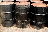Row Of Rusting Black Drums