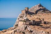 Ruins Of The Genoa Fortress In Sudak, Crimea. Black Sea, Ukraine