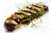 Light meal from eel. Salad with avacado, eel, lettuce and Unagi Sauce.