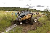 Crush Beige Jeep Rubicon Crossing Mud Obstacle