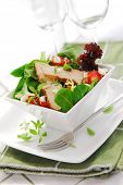 Fresh green salad with grilled chicken herbs and tomatoes