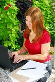 Woman working on her computer at home, small business owner
