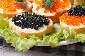 pic of butter-lettuce  - Sandwiches with red and black fish caviar on lettuce macro horizontal - JPG