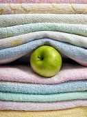 pic of cleanliness  - Apple between sorted towels as a concept of cleanliness and hygiene - JPG