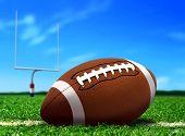 Football Ball On Grass Under Blue Sky