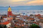 View at St.Tropez and anchored ships at sunset in French Riviera