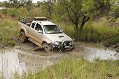 White Toyota Raider Hilux 3.0L Crossing Muddy Pond