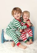 pic of pajamas  - Children in Christmas pajamas outfits smiling and laughing - JPG