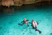 stock photo of cenote  - Sub are preparing for diving in a cenote Mexico