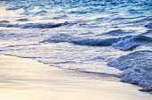Tropical Caribbean sea waves breaking on the shore