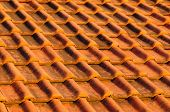 Closeup of red clay interlocking roofing tiles background