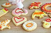 Decorating homemade shortbread cookies with icing from piping bag