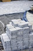 Stacks of interlocking stones for installing driveway landscaping