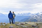 Hikers enjoying scenic Canadian Rocky Mountains view in Jasper National Park