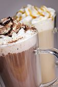 Hot chocolate and coffee latte beverages with whipped cream
